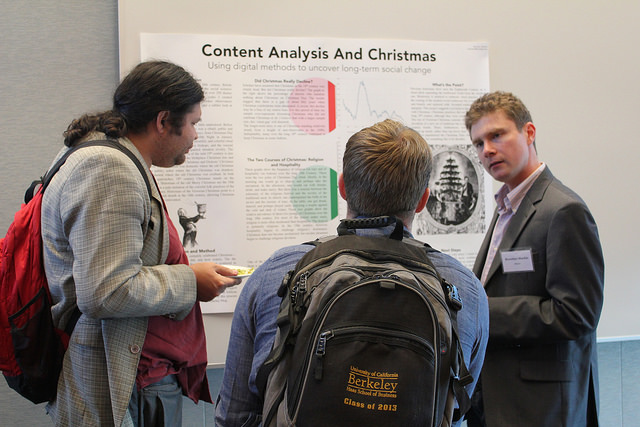 "Brendan Mackie displays his poster, ""Content Analysis and Christmas"" at DH Faire 2015"