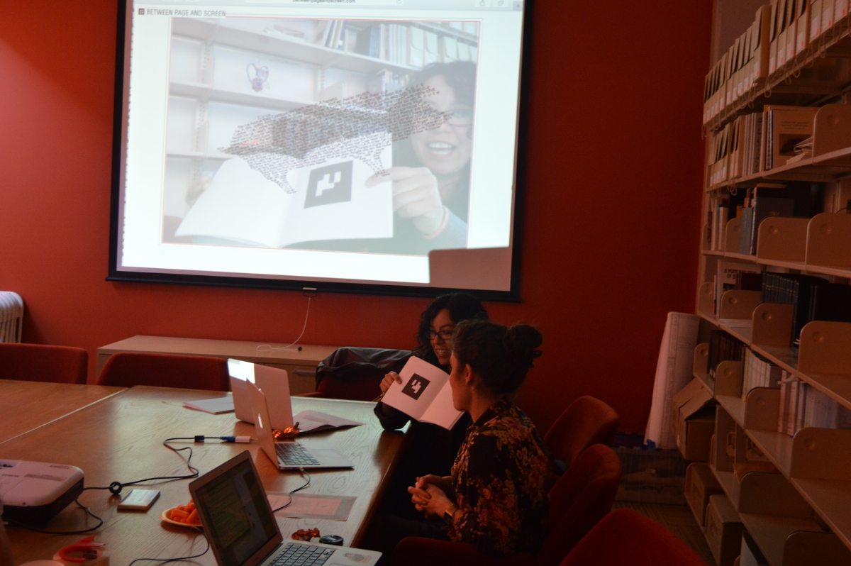 photo: Alex Saum-Pascual and Élika Ortega demonstrate Between Page and Screen by Amaranth Borsuk and Brad Bouse