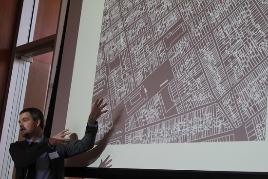 Zephyr Frank pointing to a projected map of Rio de Janeiro