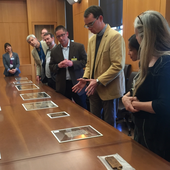 Photo: Michael Zellmann-Rohrer exhibits papyrus fragments at the Bancroft Library